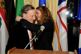 Canadian astronaut Julie Payette helps Herzberg winner John Polanyi with his medal.