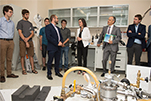 Professor Michel Pioro-Ladrière, Deputy Director of the Institut quantique, Université de Sherbrooke alongside some students gives a tour of the 'Quantum Fab Lab' at the Institut quantique to the Honourable Kirsty Duncan, Minister of Science and Sport