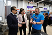 The Honourable Kirsty Duncan, Minister of Science and Sport and Dr. B. Mario Pinto, President, NSERC visiting the Kids Code Jeunesse exhibit at the STEM Expo