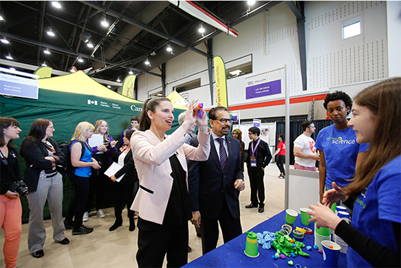 The Honourable Kirsty Duncan, Minister of Science and Sport and Dr. B. Mario Pinto visiting the Let's Talk Science exhibit at the STEM Expo