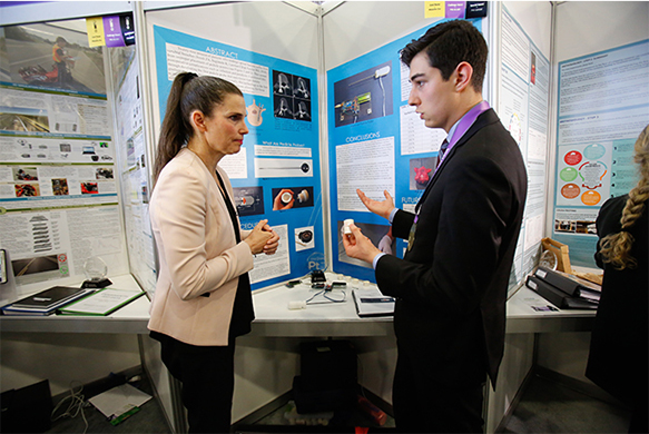 The Honourable Kirsty Duncan, Minister of Science and Sport with Nicolas Fedrigo, Best Senior Project winner, Canada-Wide Science Fair